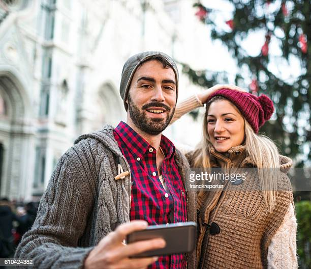 couple on the city of Florence for christmas take selfie