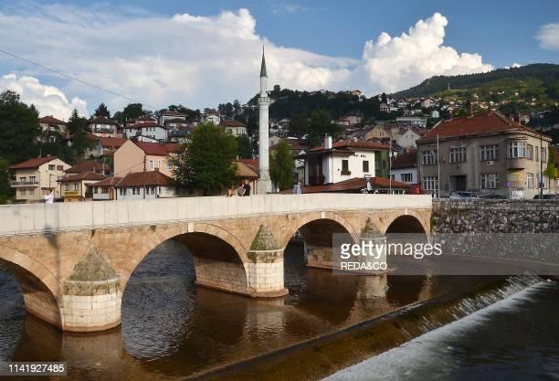 Couple on the Latin Bridge . Across the River Miljacka. Sarajevo. Bosnia. Bosnia-Herzegovina. Europe.
