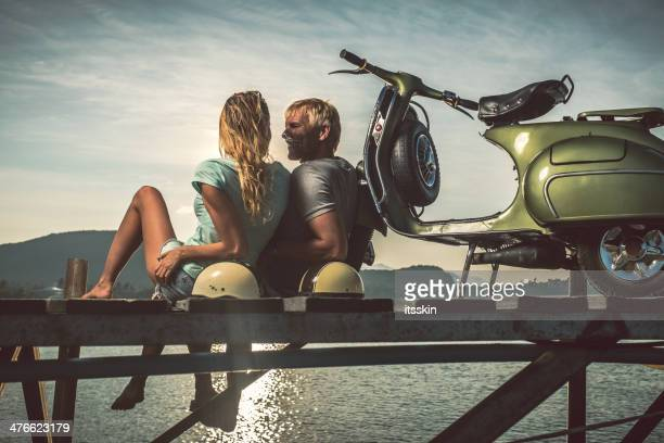 Couple on the pier with retro bike