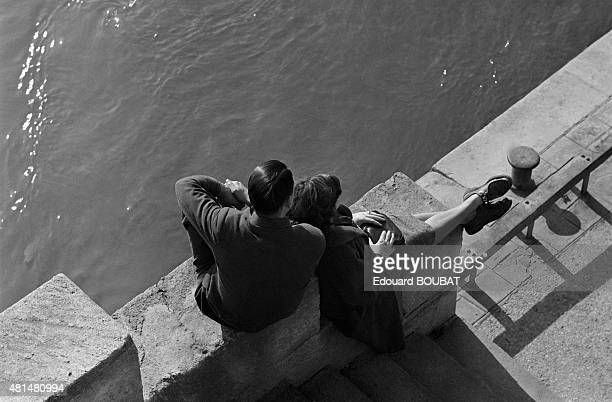 Couple on the quays along the Seine in Paris, France.