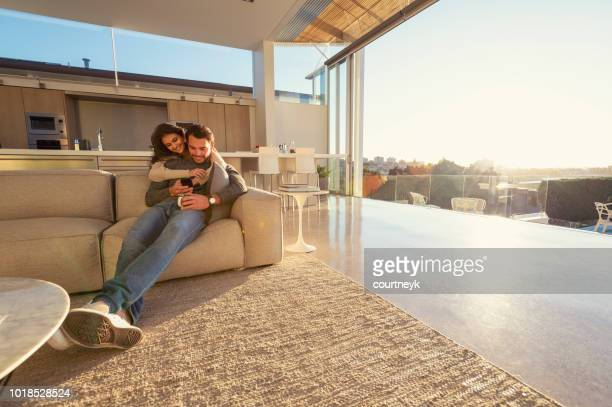 couple on the sofa at sunrise. - wide angle stock pictures, royalty-free photos & images