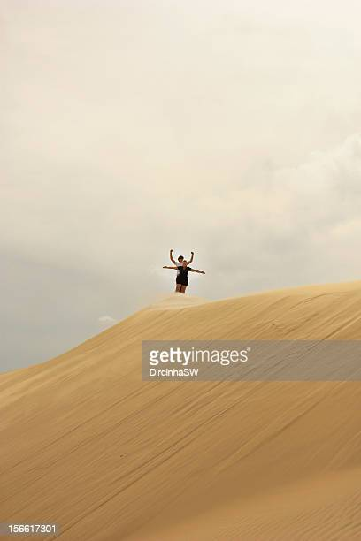 Couple on top at sand dunes.