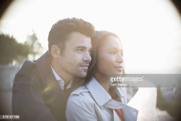 Couple on urban balcony