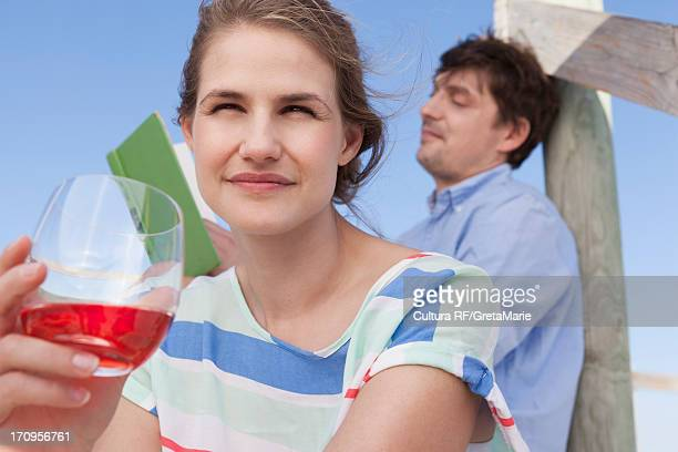 Couple on vacation, woman with soft drink