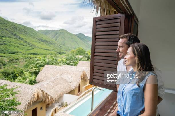 Couple on vacations looking at the view of their hotel room