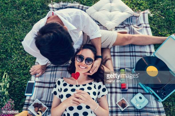couple on valentine's day - picnic blanket stock pictures, royalty-free photos & images