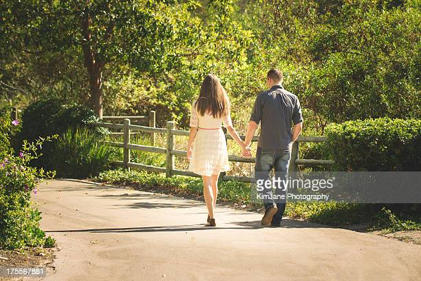 couple on walk - jane walker wood stock pictures, royalty-free photos & images