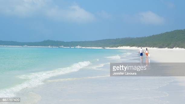 couple on whitehaven beach - whitehaven beach stock photos and pictures