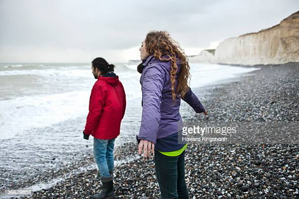 couple on windswept beach in winter