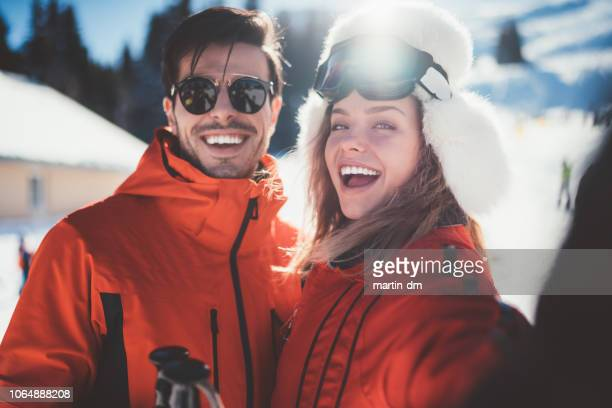 couple on winter holiday taking selfie - winter sport stock pictures, royalty-free photos & images