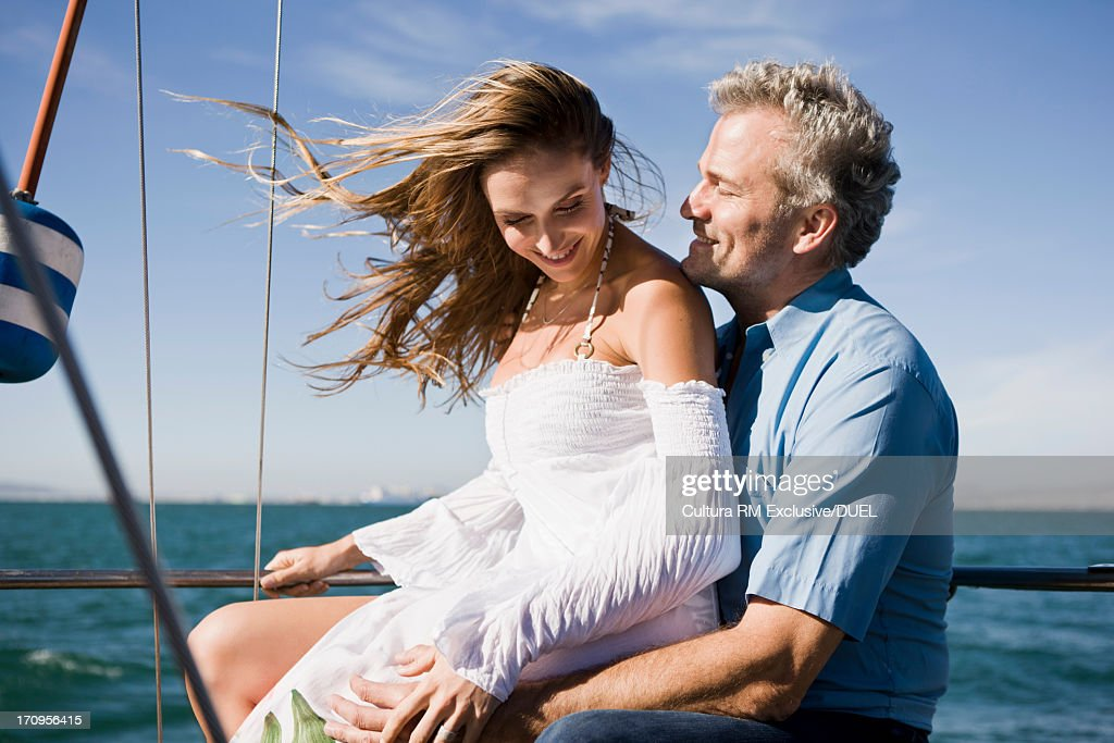 Couple on yacht laughing : Stock Photo