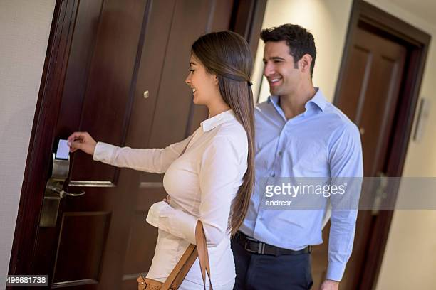 Couple opening their hotel room