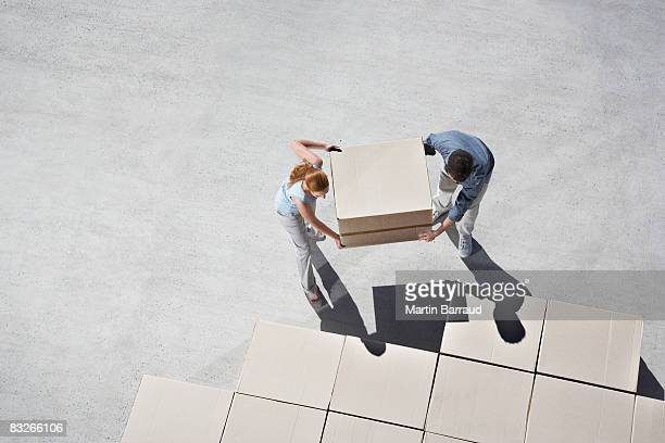 Couple organizing boxes