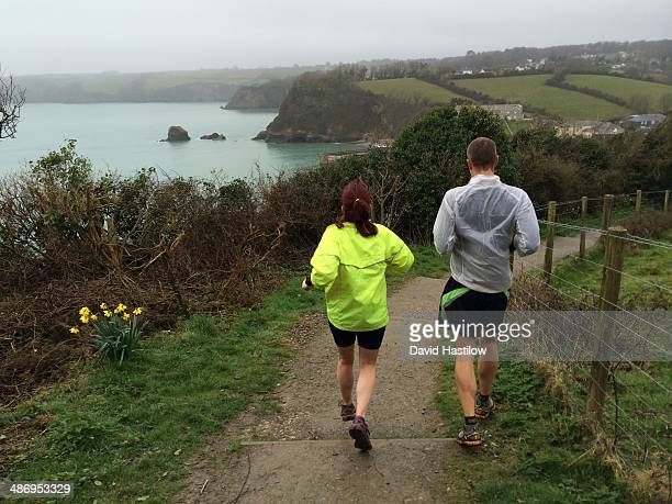 Couple out for a morning run on the Cornwall coast path