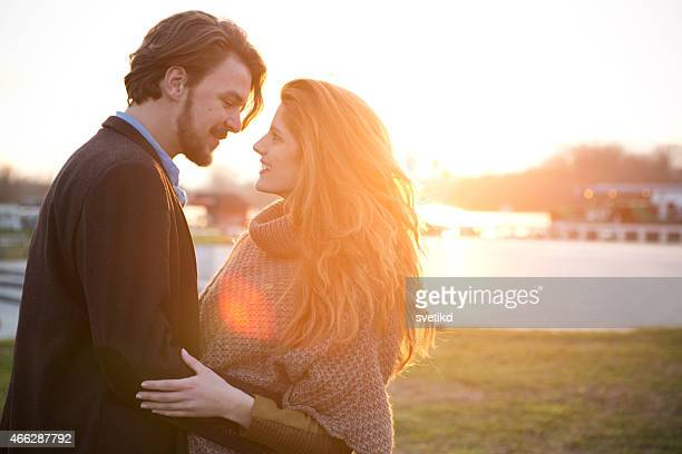 Couple outdoors at sunset.