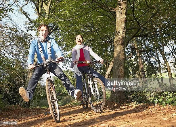 Couple outdoors having fun riding bicycles