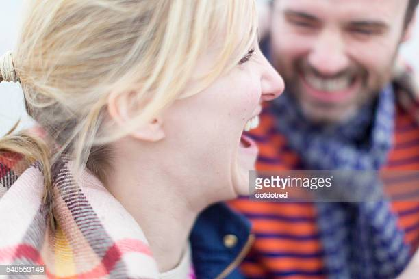 Couple outdoors, laughing