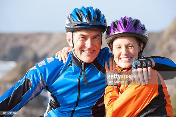 couple outdoors on bicycle embracing