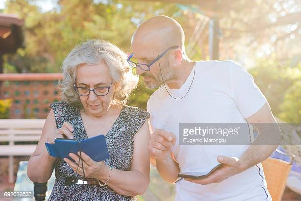 Couple outdoors using smartphones