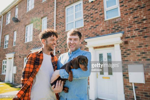 couple outside their new home - in front of stock pictures, royalty-free photos & images