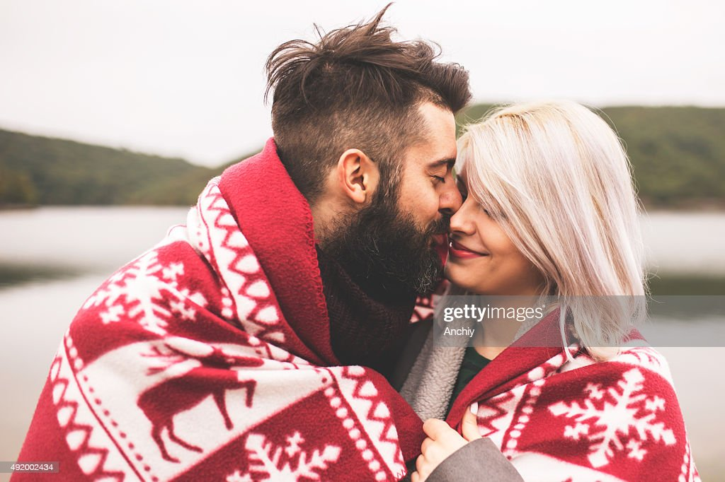 Couple outside under the blanket : Stock Photo