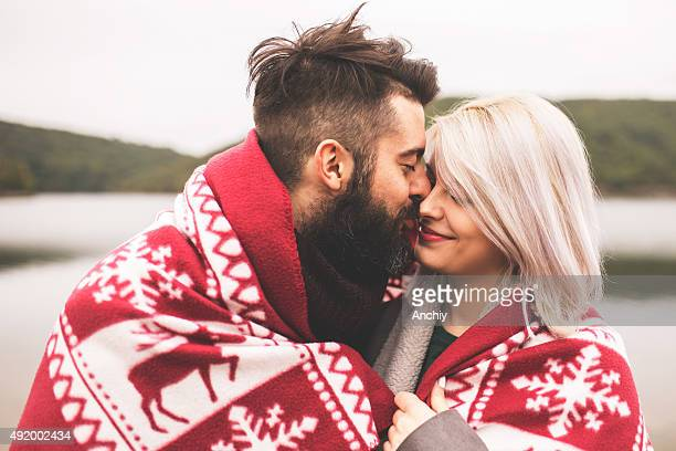 couple outside under the blanket - heterosexual couple photos stock photos and pictures
