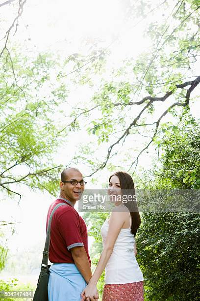 Couple Outside, Walking, Holding Hands