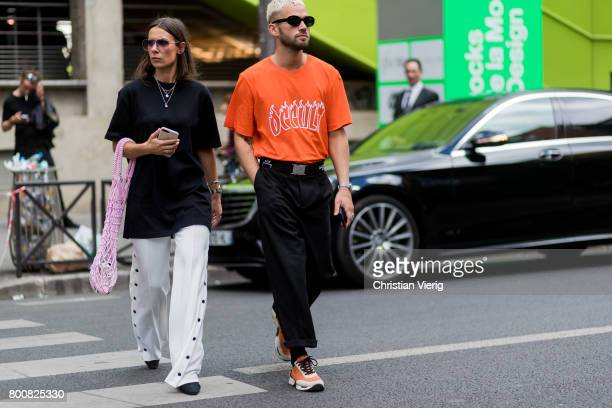 A couple outside Y3 during Paris Fashion Week Menswear Spring/Summer 2018 Day Five on June 25 2017 in Paris France