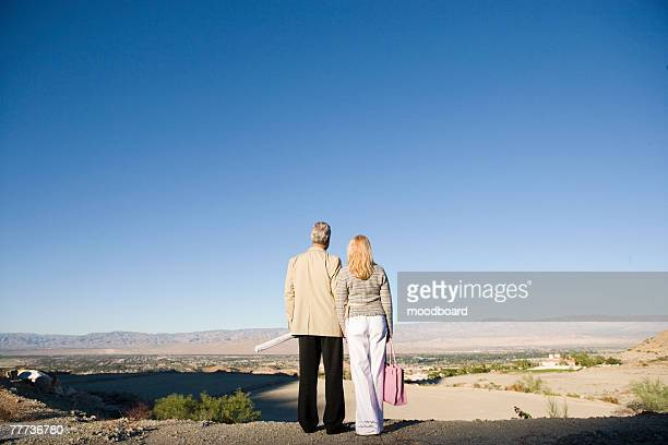 Couple Overlooking Future New Home