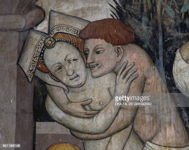 Couple overwhelmed by passion while bathing in the Fountain of Youth detail from the Fountain of Youth fresco in the Baronial Hall Castle of Manta...