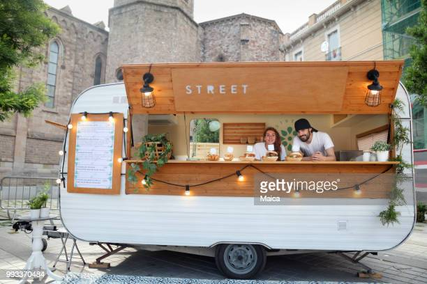 couple owners food truck - food truck stock pictures, royalty-free photos & images