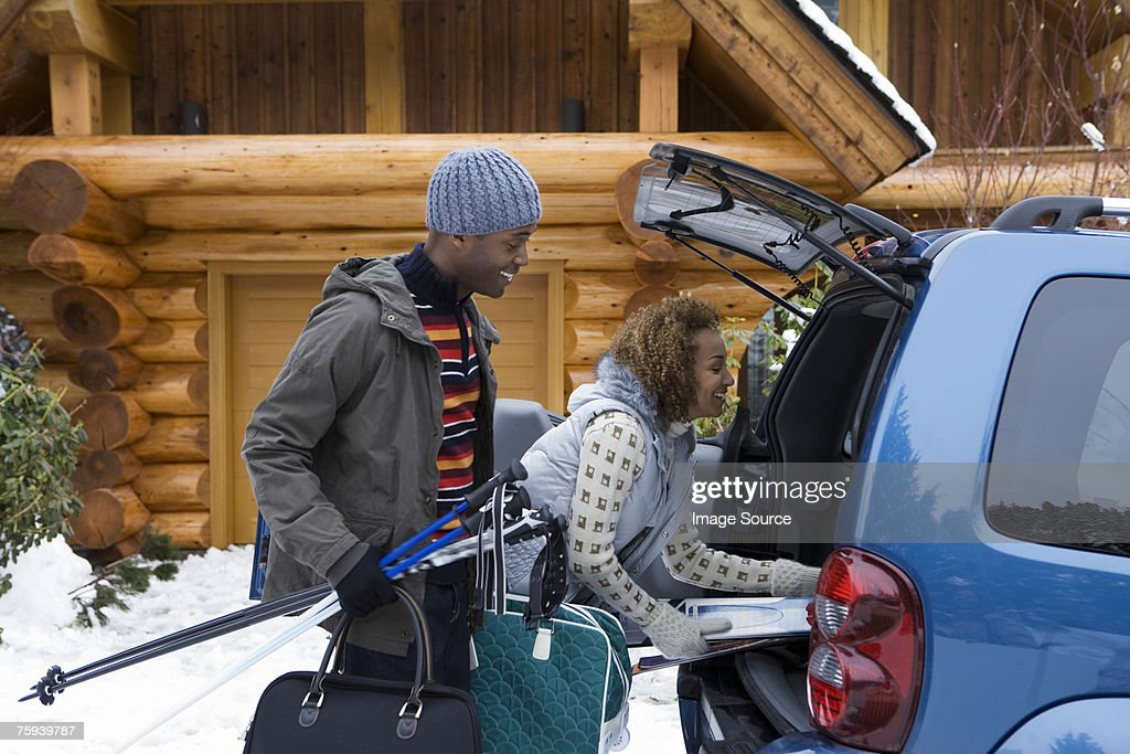 Couple packing car boot : Stock Photo