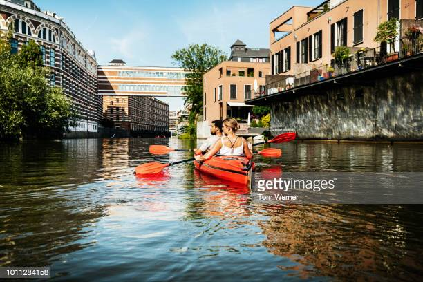 Couple Paddling Down Inner City Canals