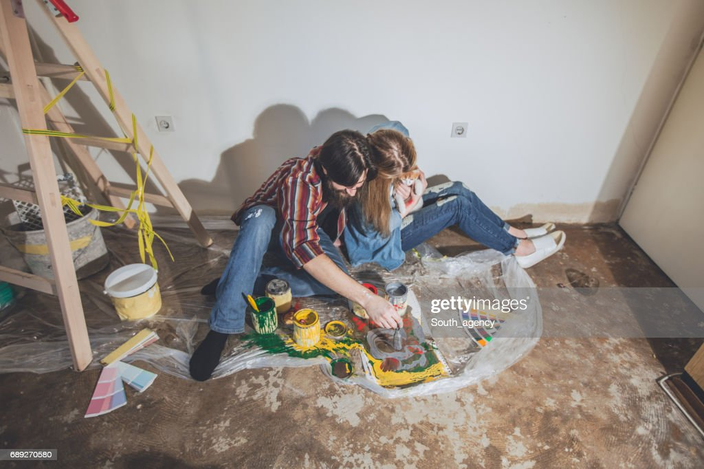 Couple painting new apartment : Stock Photo