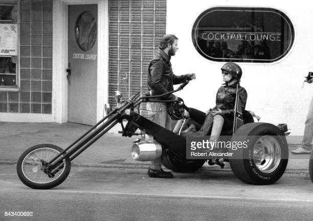 A couple park their motorcycle 'trike' in Daytona Beach Florida during the city's 1983 Bike Week The annual motorcycle event and rally has attracted...