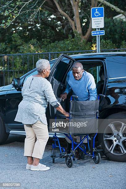 couple parked in handicapped parking space - disabled sign stock photos and pictures