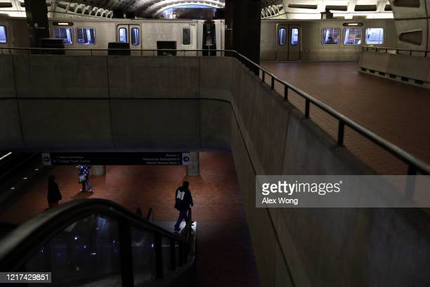 A couple passengers are seen at an empty Metro Center Station April 7 2020 in Washington DC Washington Metropolitan Area Transit Authority announced...
