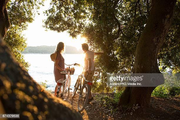 couple pause with bikes, in forest above sea - croacia fotografías e imágenes de stock