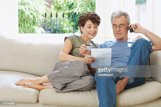 Couple Paying Bill Over Phone
