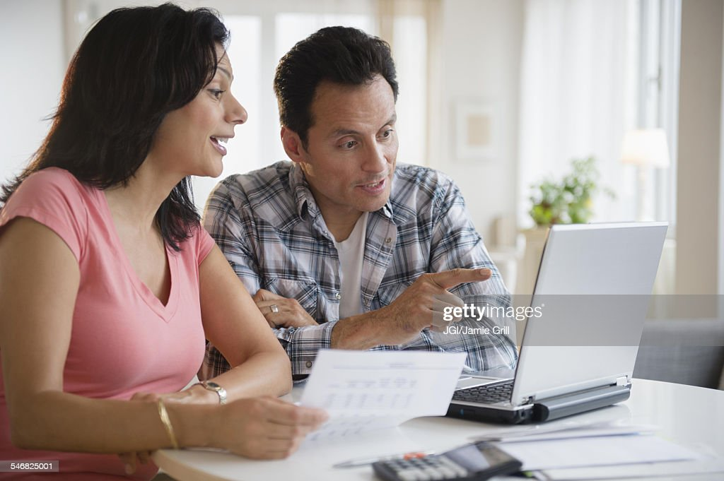 Couple paying bills online : Stock Photo