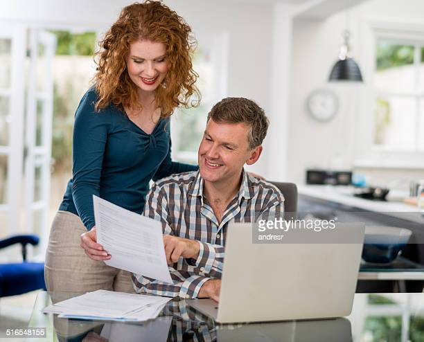 Couple paying the bills online