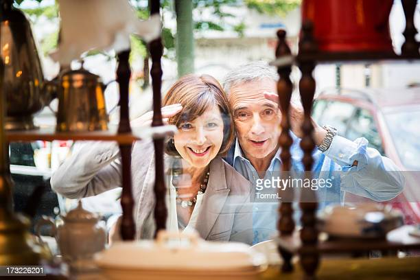 Couple Peeking Through Shopping Window
