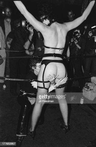 A couple perform for the spectators at the 'Hellfire Club' a Sadomasochism club night in the pregentrified Meatpacking District New York City 1981