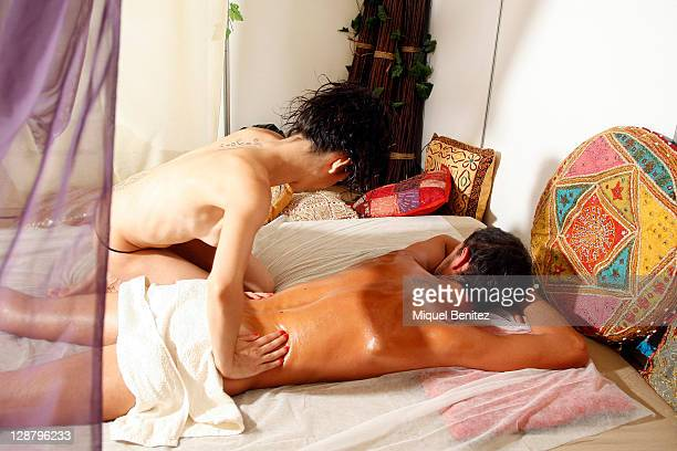 A couple performs a Tantra massage in a stand at the Barcelona Erotic Fair on October 8 2011 in Barcelona Spain