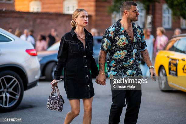 Couple Pernille Teisbaek and Philip Lotko seen outside Saks Potts during the Copenhagen Fashion Week Spring/Summer 2019 on August 9 2018 in...