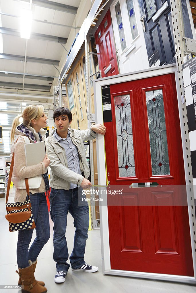Couple picking new front door in shopping store : Stock Photo