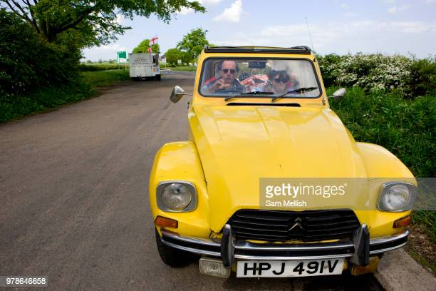 A couple picnic in their Citroën CV parked near a burger van in a rural layby on the 09th May 2011 near Newcastle in the United Kingdom