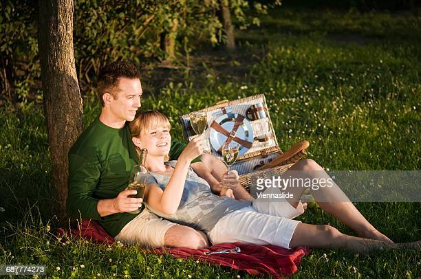 Couple picnicking in a field