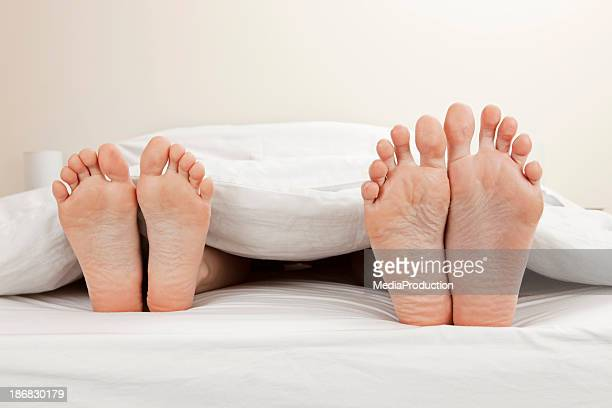 couple - beautiful male feet stock photos and pictures