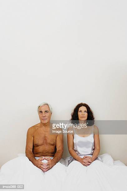 couple - double bed stock pictures, royalty-free photos & images